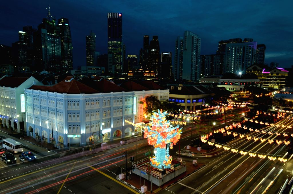 SINGAPORE, Sept. 20, 2017 - Decorations in lantern shape are lightened up to celebrate the Mid-Autumn festival at Singapore's Chinatown on Sept. 20, 2017.