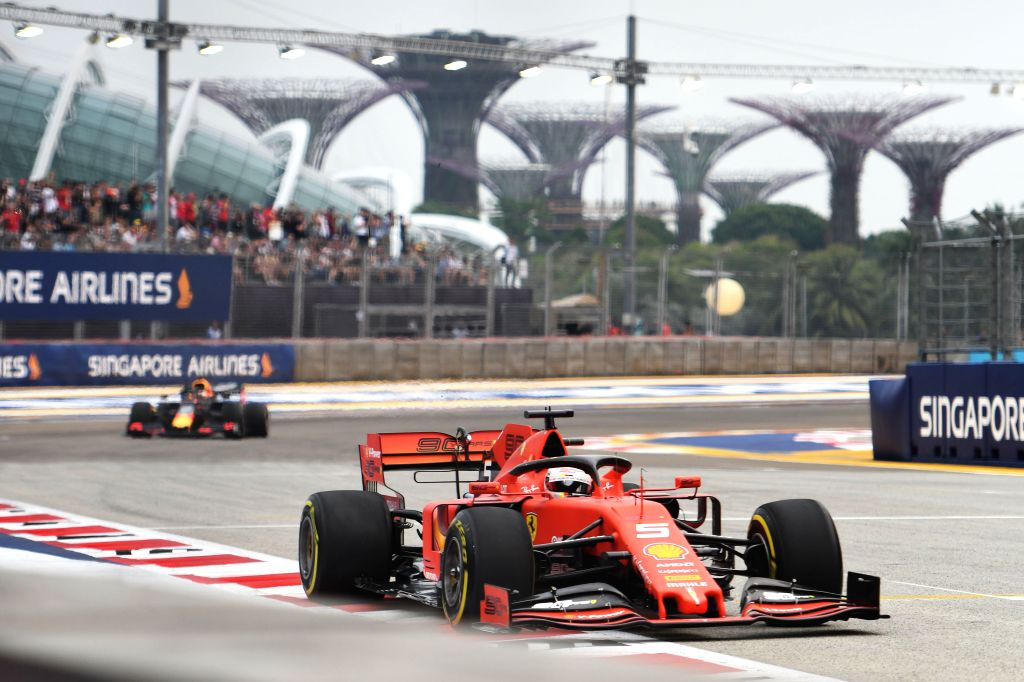 SINGAPORE, Sept. 20, 2019 - Sebastian Vettel (Front) of Ferrari and Dutch driver Max Verstappen of Red Bull drive during the first practice session of the Formula One Singapore Grand Prix held at the ...