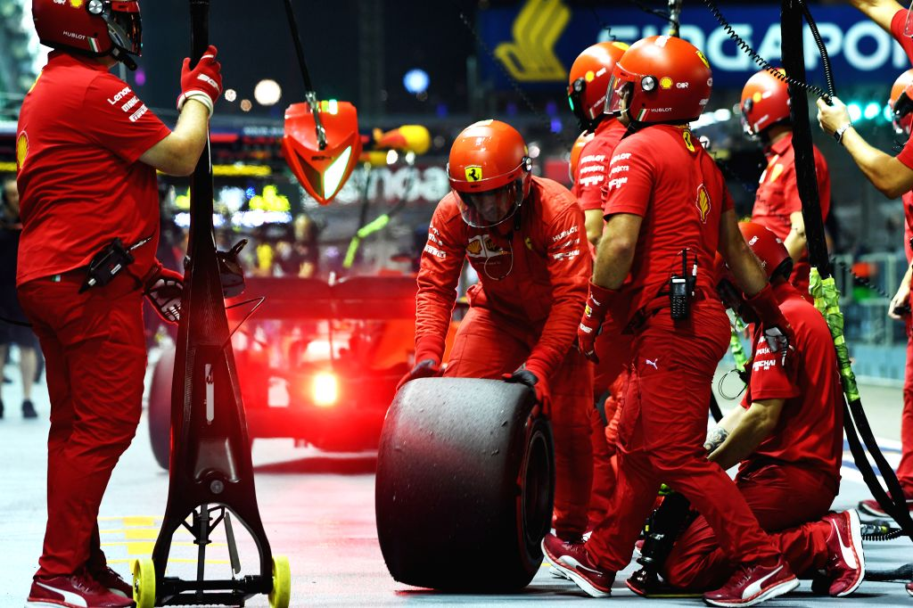SINGAPORE, Sept. 21, 2019 - The pit crew of Ferrari perform a change of tires during the second practice session of the Formula One Singapore Grand Prix held at the Marina Bay Street Circuit in ...