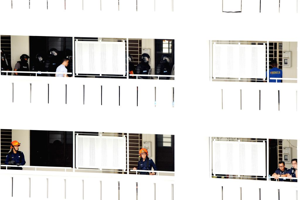 SINGAPORE, Sept. 28, 2016 - Members of the Singapore Police Force (SPF) Special Tactics and Rescue (top) await outside a public housing unit during a hostage rescue operation in Singapore's ...