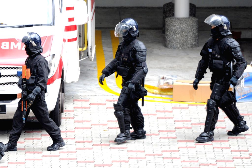 SINGAPORE, Sept. 28, 2016 - Members of the Singapore Police Force (SPF) Special Tactics and Rescue prepare for a hostage rescue operation in Singapore's Sembawang, Sept. 28, 2016. The SPF ...