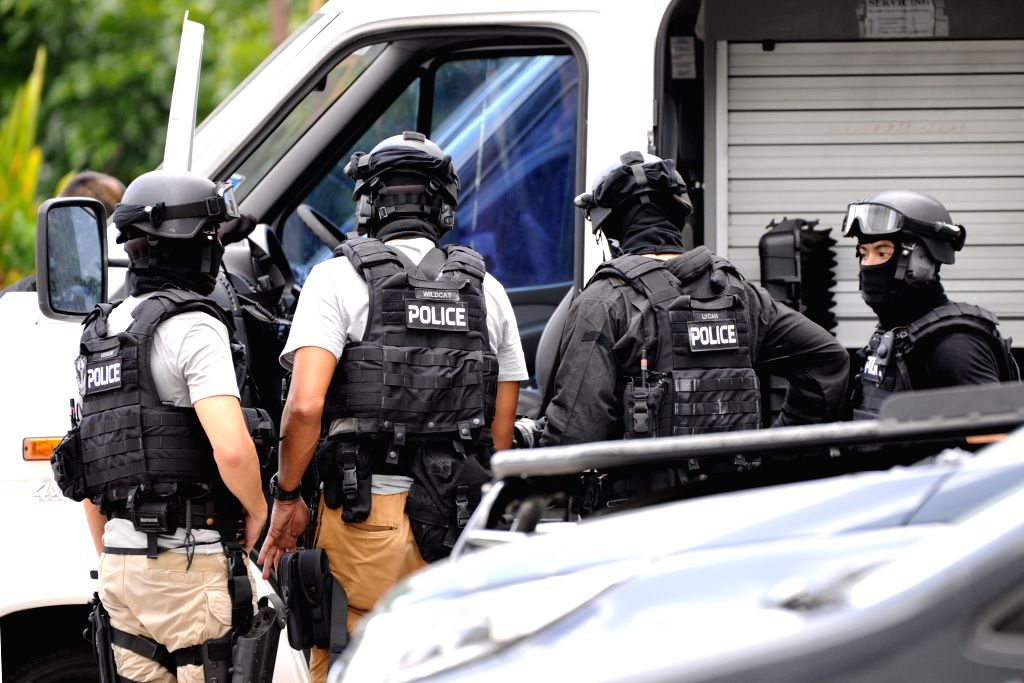 SINGAPORE, Sept. 28, 2016 - Members of the Singapore Police Force (SPF) Special Tactics and Rescue prepare to leave after a hostage rescue operation in Singapore's Sembawang, Sept. 28, 2016. The SPF ...