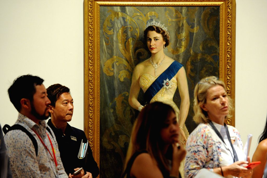 SINGAPORE, Sept. 30, 2016 - Journalists visit the preview of an exhibition at the National Gallery Singapore, Sept. 30, 2016. The National Gallery Singapore held a media preview of the exhibition ...