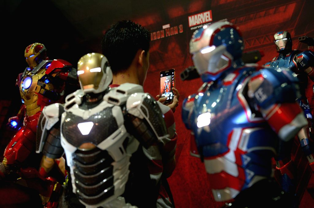 A visitor takes photos of the toys during the Singapore Toy, Game and Comic Convention (STGCC) in Singapore's Marina Bay Sands Expo on Sept. 6, 2014. The STGCC ...
