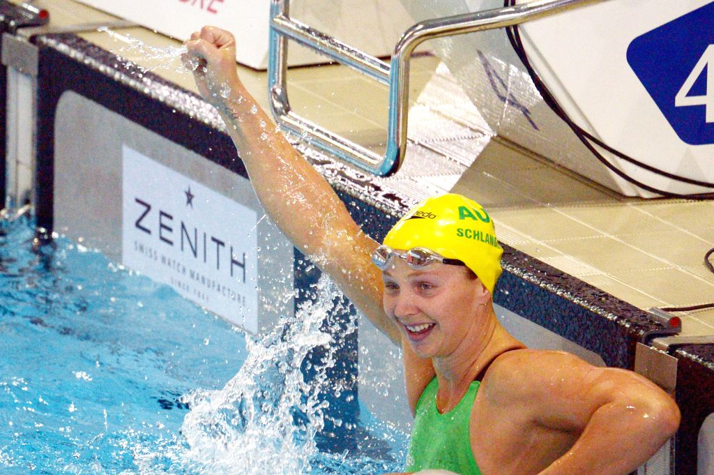 Australia's Melanie Schlanger celebrates after the women's 100m freestyle event during the Singapore Swim Stars Challenge held in Singapore's Sports Hub OCBC ...