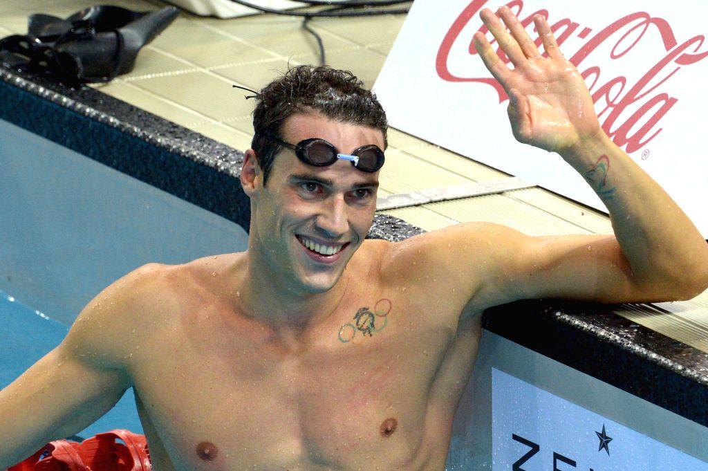 Italy's Fabio Scozzoli celebrates after the men's 100m breaststroke event during the Singapore Swim Stars Challenge held in Singapore's Sports Hub OCBC Aquatic ...