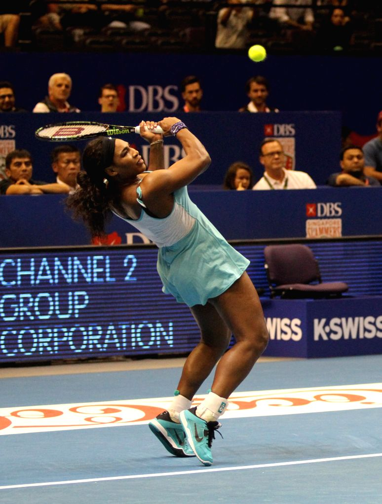Tennis player Serena Williams hits a return during the first International Premier Tennis League (IPTL) at the Singapore Indoor Stadium, Dec. 2, 2014. The star-driven IPTL was founded in ..