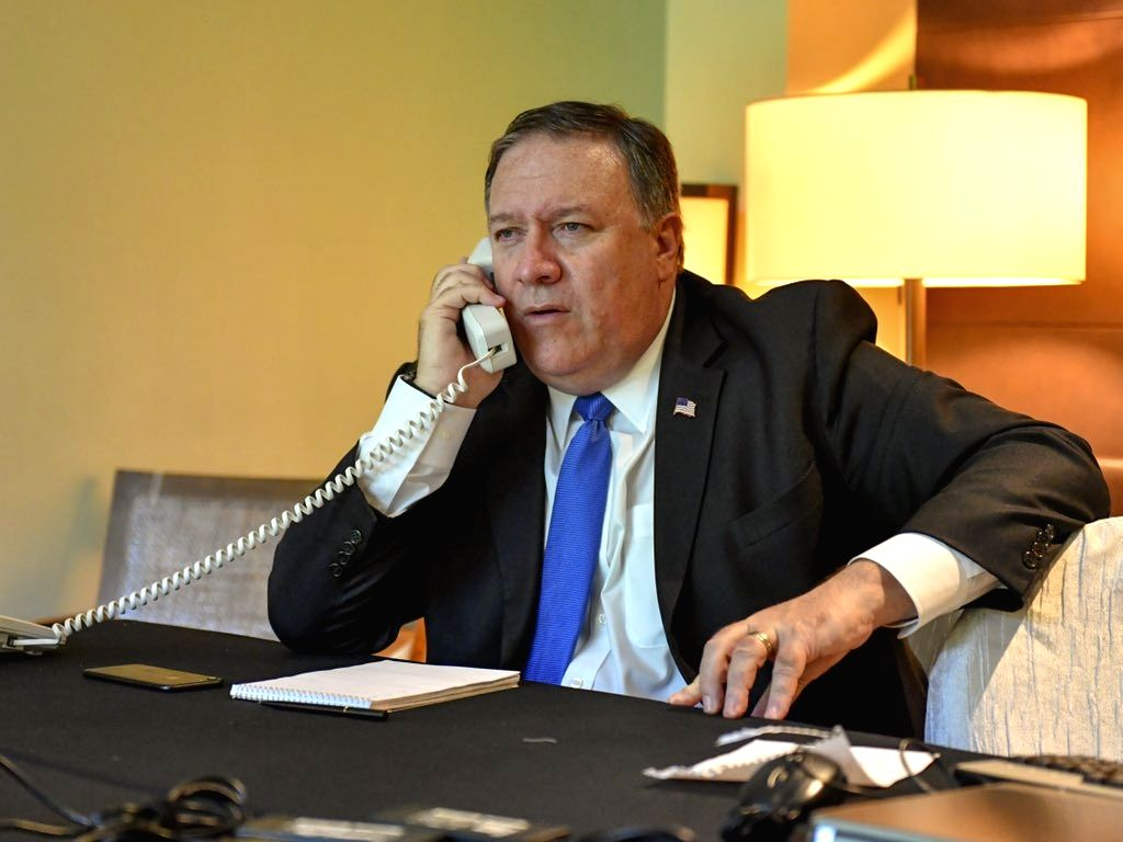 Singapore: U.S. Secretary of State Mike Pompeo talks to Foreign Minister Kang Kyung-wha to explain the outcome of the summit between U.S. President Donald Trump and North Korean leader Kim Jong-un in Singapore on June 12, 2018, in this photo captured - Kang Kyung