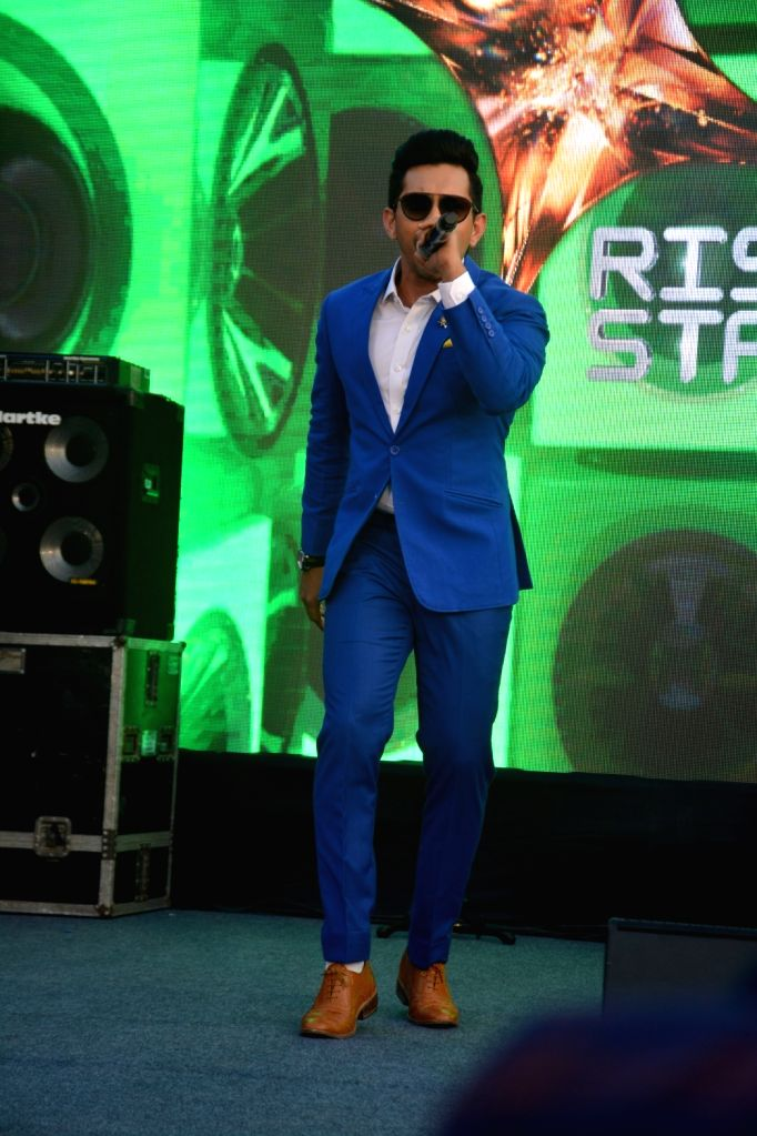 """Singer Aditya Narayan performs at the launch of third edition of live singing reality show """"Rising Star"""" in Mumbai, on March 13, 2019."""