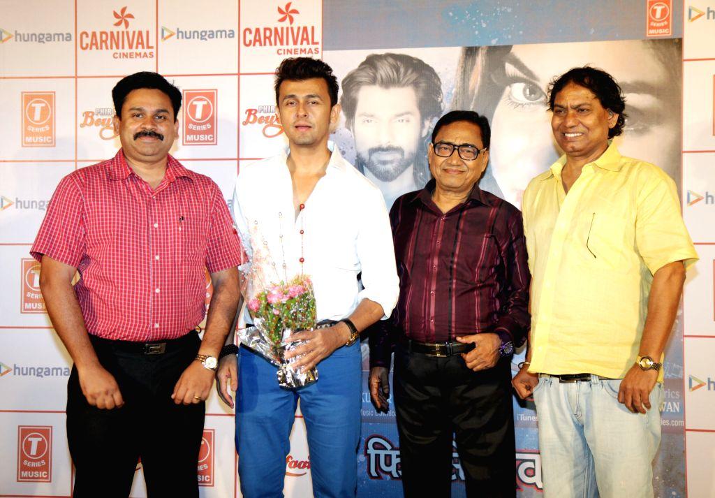 Singer Agam Kumar Nigam along with his son Sonu Nigam during the launch of his 6th album `Phir Se Bewafaai` at Carnival Cinemas Oshiwara in Mumbai on Aug 12, 2015. - Sonu Nigam and Agam Kumar Nigam