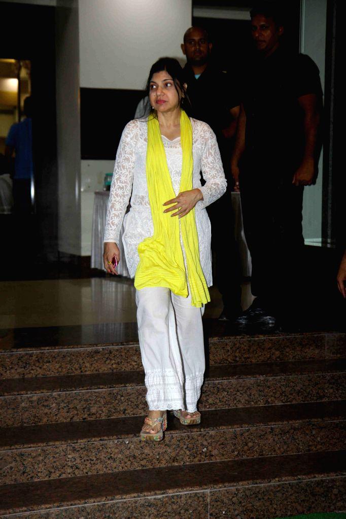 Singer Alka Yagnik during the prayer meet of Pandit Pandharinath Kolhapure, in Mumbai, on Aug 18, 2015. Pandit Pandharinath, who expired on August 15, 2015, is the father of actor Shraddha ... - Shraddha Kapoor and Shivangi Kapoor