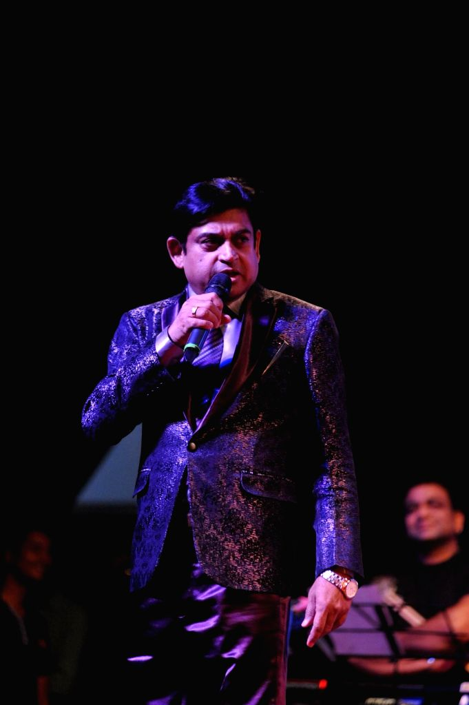 Singer Amit Kumar performs during the musical tribute `Ye Shaam Mastani` on the occasion of 86th birthday celebration of late singer Kishore Kumar in Mumbai, on August 2, 2015. - Amit Kumar