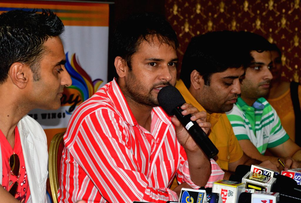 Singer and actor Amrinder Gill and others during a press conference for his upcoming film `Goreyan Nu Dafa Karo` in Amritsar on Sept 8, 2014. - Amrinder Gill