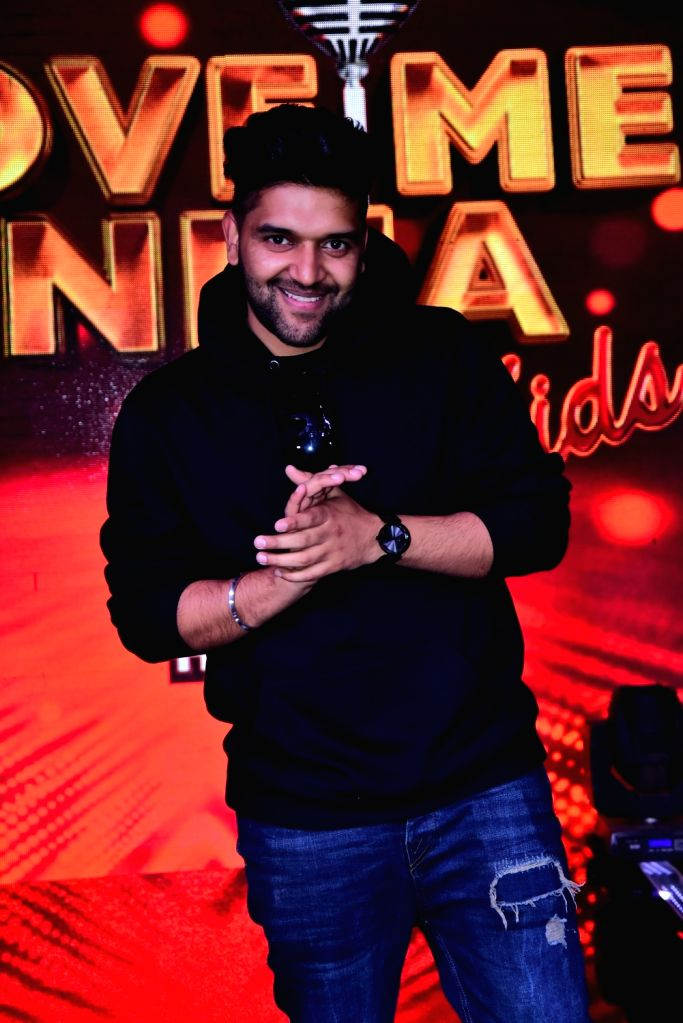 """Singer and judge of singing reality television show for kids """"Love Me India"""" Guru Randhawa on the sets of the show, in Mumbai on Sept 15, 2018."""