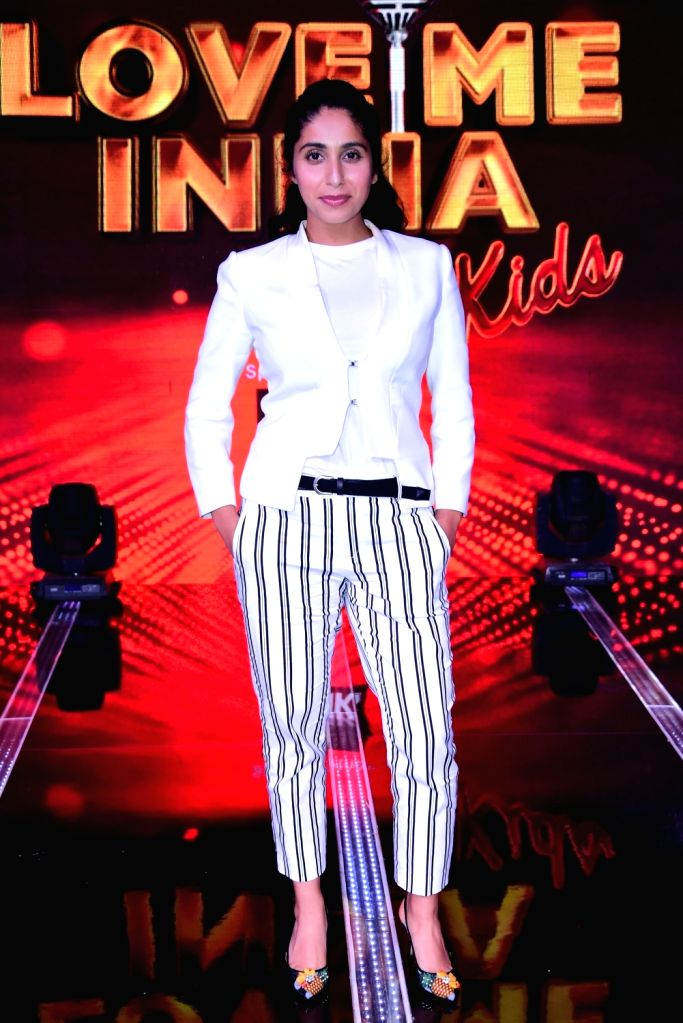 """Singer and judge of singing reality television show for kids """"Love Me India"""" Neha Bhasin on the sets of the show, in Mumbai on Sept 15, 2018."""