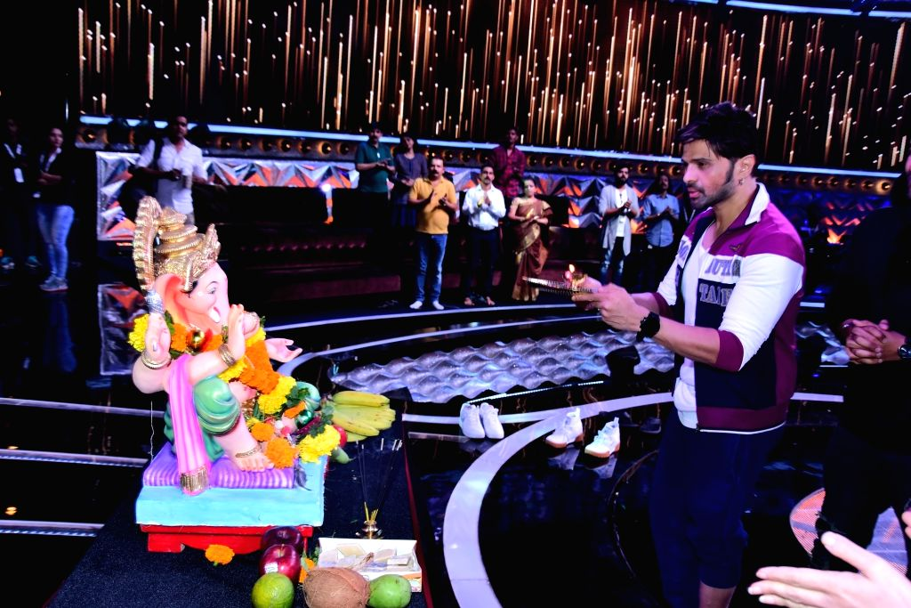 """Singer and judge of singing reality television show for kids """"Love Me India"""" Himesh Reshammiya performs Ganesh 'arti' during Ganesh Chaturthi celebrations on the sets of the show, ..."""