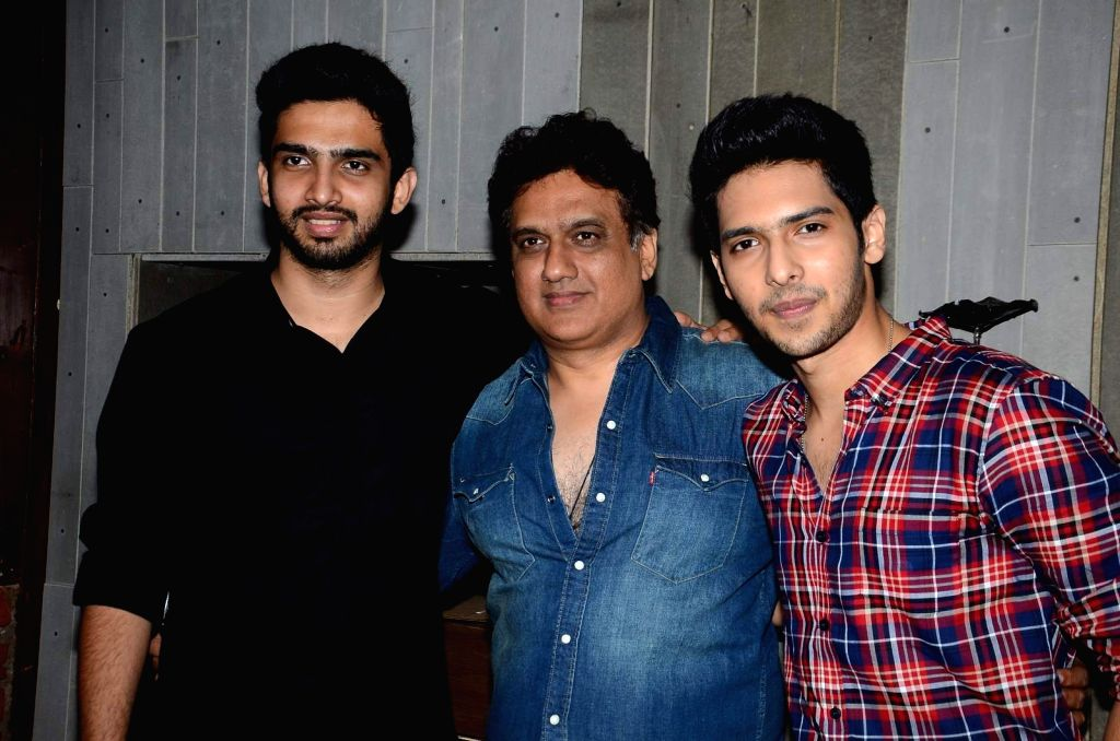 Singer Armaan Malik with father and music composer Daboo Malik and singer Amaal Malik during his birthday party in Mumbai, on July 22, 2015.