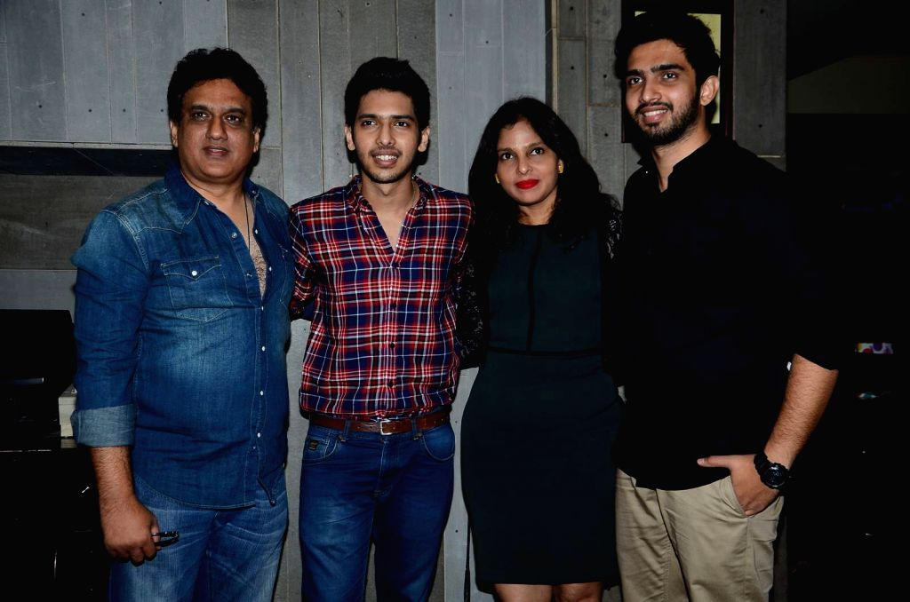 Singer Armaan Malik with his father Daboo Malik, mother, and singer Amaal Malik during his birthday party in Mumbai, on July 22, 2015.