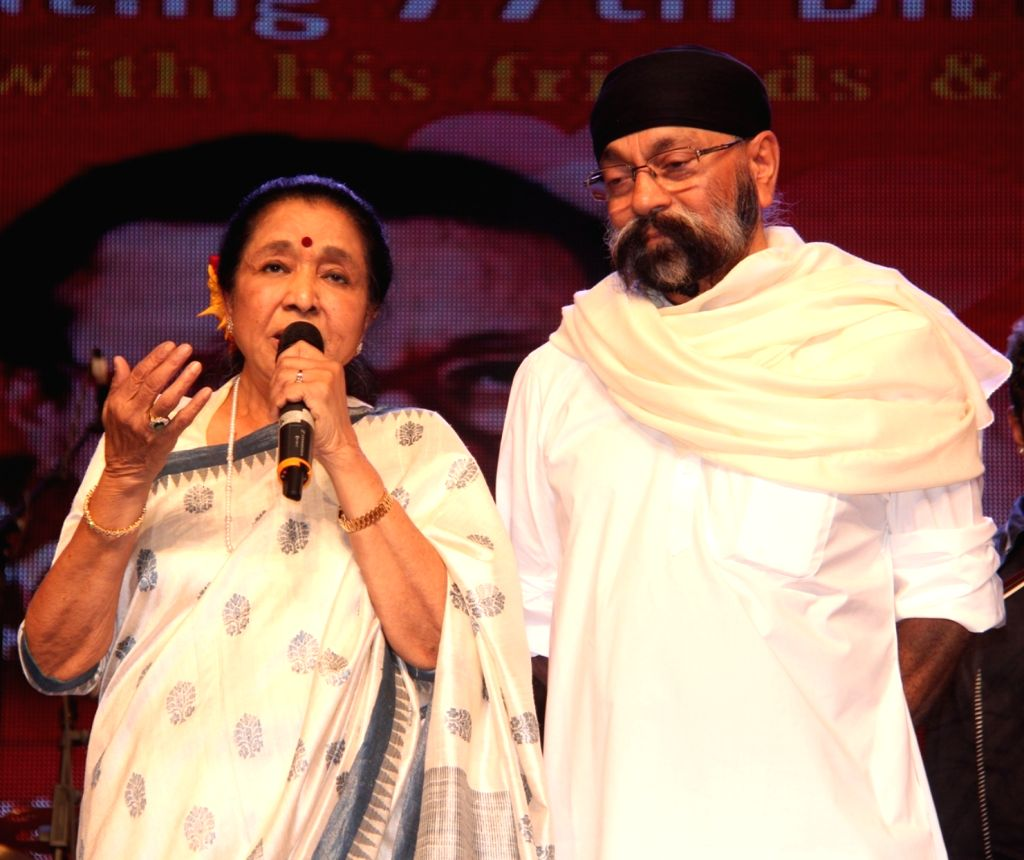 Singer Asha Bhosle and Uttam Singh during the 77th birthday celebration of late Bollywood music director R D Burman, in Mumbai on June 24, 2016. - R D Burman, Asha Bhosle and Uttam Singh