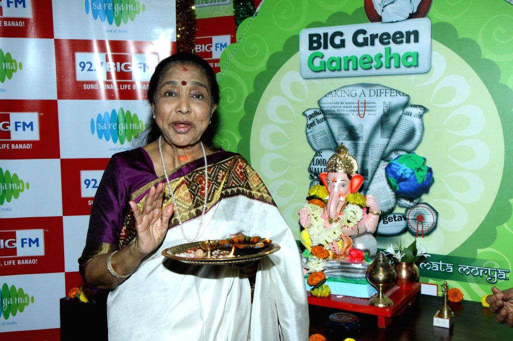Singer Asha Bhosle at her birthday special show recording and Ganesh Pooja at 92.7 BIG FM office in Mumbai on Sept 1, 2014.