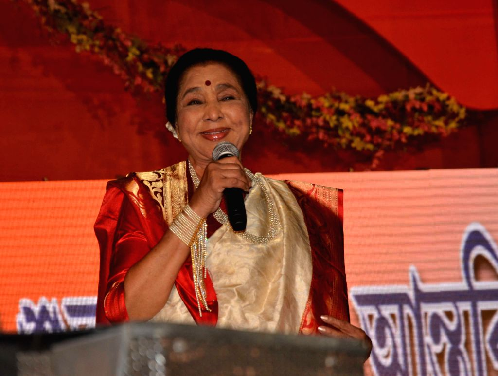 Singer Asha Bhosle performs during a programme in Kolkata on April 15, 2014.