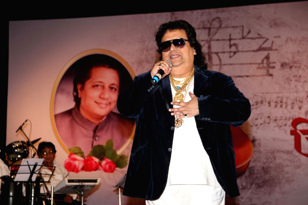 Singer Bappi Lahiri at a function organized by Sath Sangat and Surel Creations in association with 9X Jhakaas. Eminent names from the music industry had come together to pay a rich musical tribute to