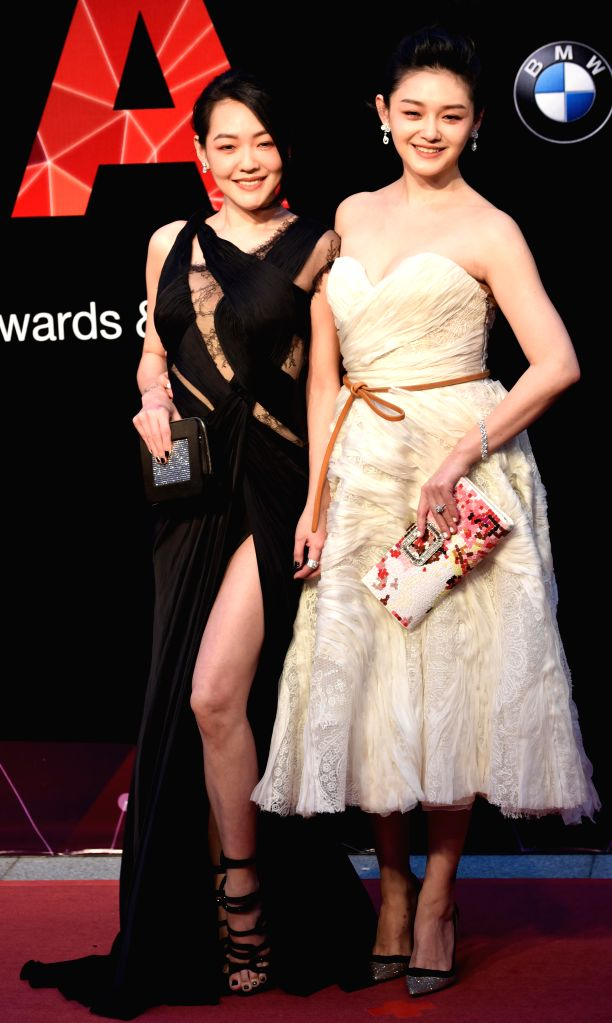 Singer Barbie Hsu (R) and hostess Elephant Dee poses on the red carpet as they arrive for the 26th Golden Melody Awards in Taipei, southeast China's Taiwan, June 27, ...