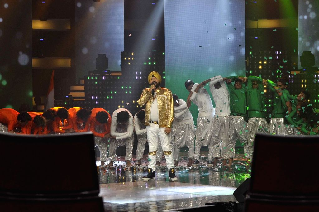 Singer Daler Mehandi perform on the sets of & TV Voice India for the special episode shoot for Independence Day in Mumbai, on Aug 10, 2015.