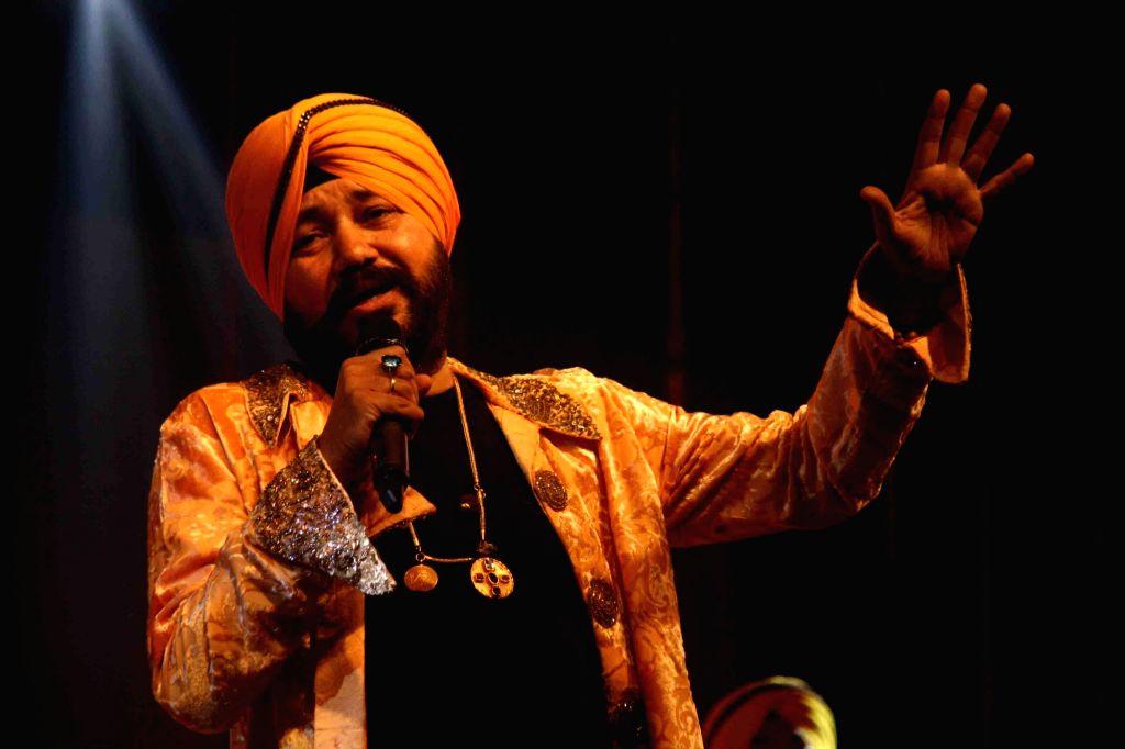 Singer Daler Mehndi performs during a programme in Patna on April 13, 2016.