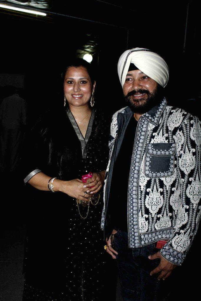 Singer Daler Mehndi with his wife Taranpreet Kaur Mehndi during the screening of film Jaanisaar in Mumbai, on August 6, 2015. - Taranpreet Kaur Mehndi