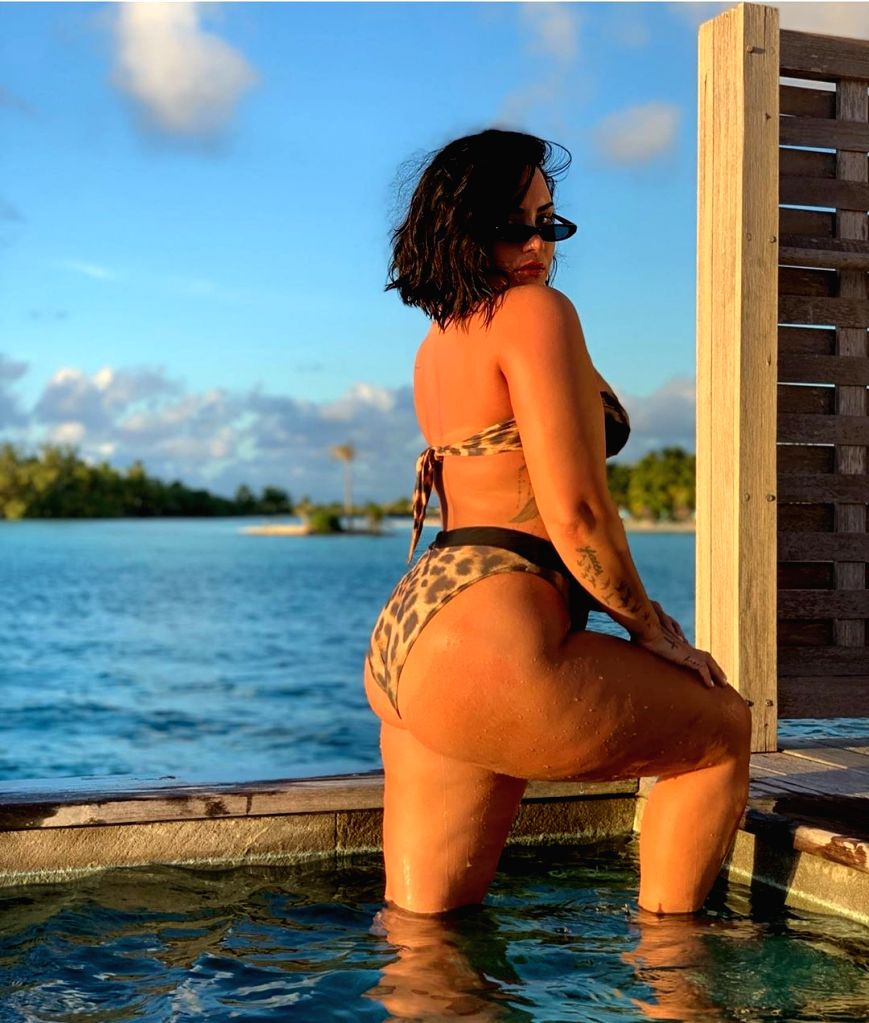 Singer Demi Lovato says she faced her biggest fear by sharing an unedited bikini photograph. Lovato shared the unedited shot on Instagram on Thursday, and explained the reason behind going ...