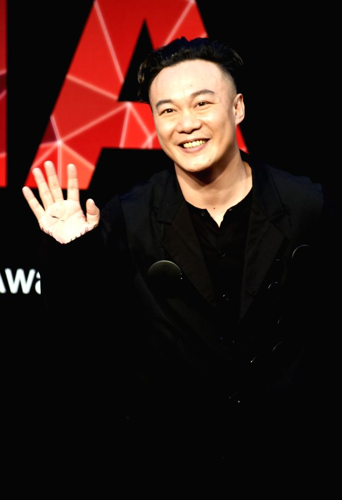 Singer Eason Chan poses on the red carpet as he arrives for the 26th Golden Melody Awards in Taipei, southeast China's Taiwan, June 27, 2015. (Xinhua/Wu ...