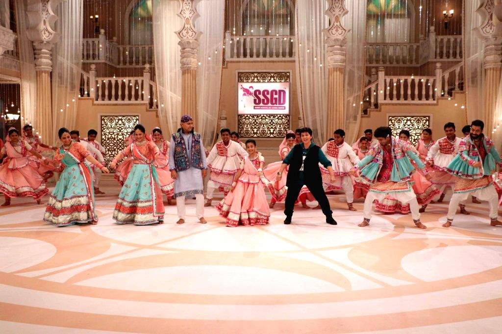 "Singer Falguni Pathak in stills from Garba Brothers - Jigar Soni and Suhrad Soni's video song ""Radha Ne Shyaam' - a track that promotes the true essence of authentic Garba. - Falguni Pathak"