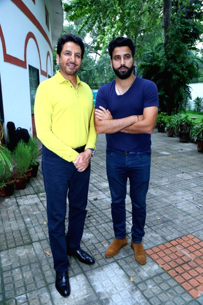 """Singer Gurdas Maan along with son Gurickk G Maan during the promotion of the song """"Mittar Pyare Nu"""" from his upcoming music album 'Punjab' in New Delhi on Aug 9, 2017."""
