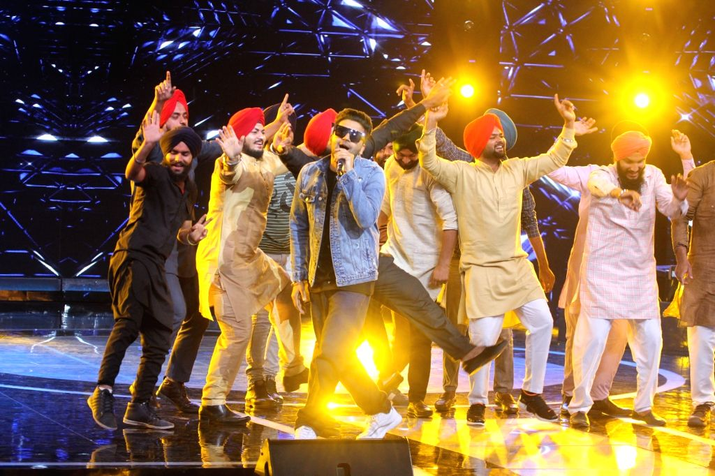 Singer Guru Randhawa performs for his fans on the sets of musical reality television show 'Sa Re Ga Ma Pa' in Mumbai, on April 25, 2019.