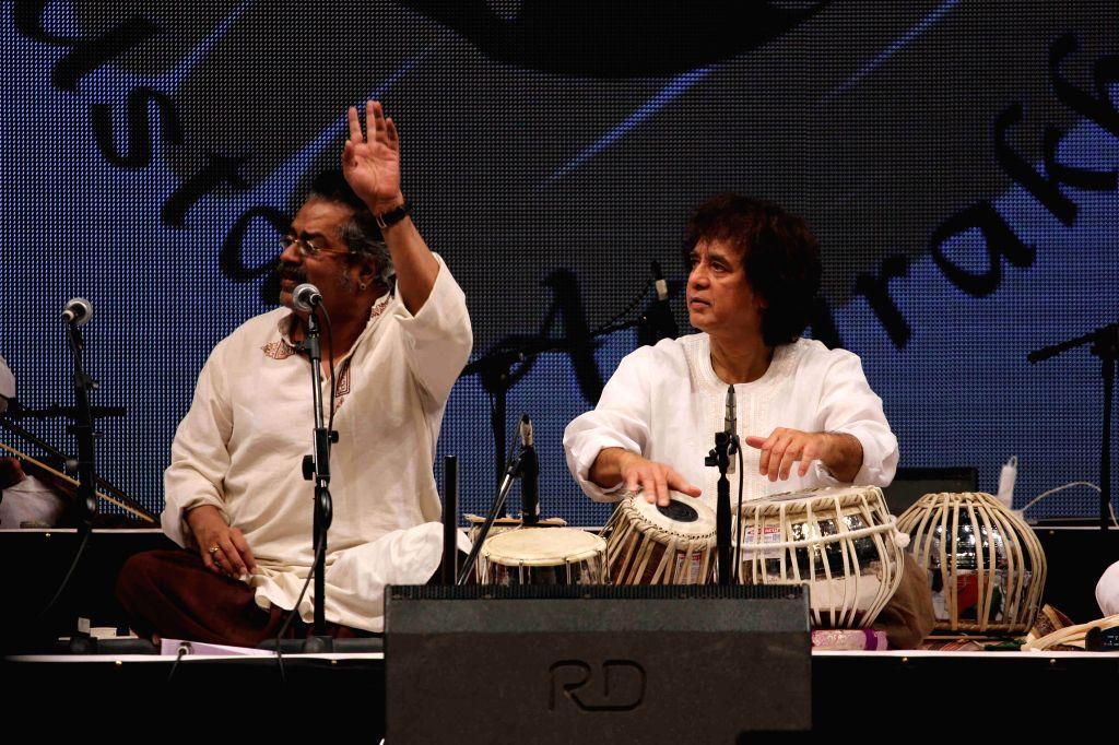 Singer Hariharan and Tabla maestro Ustad Zakir Hussain performs during the concert organised by Ustad Allarakha Institute of Music to mark the death anniversary of tabla legendary Ustad Allarakha ... - Ustad Allarakha Khan