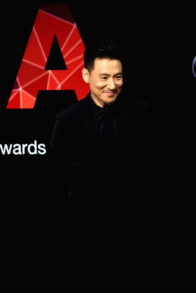 Singer Jacky Cheung poses on the red carpet as he arrives for the 26th Golden Melody Awards in Taipei, southeast China's Taiwan, June 27, 2015. (Xinhua/Wu ...