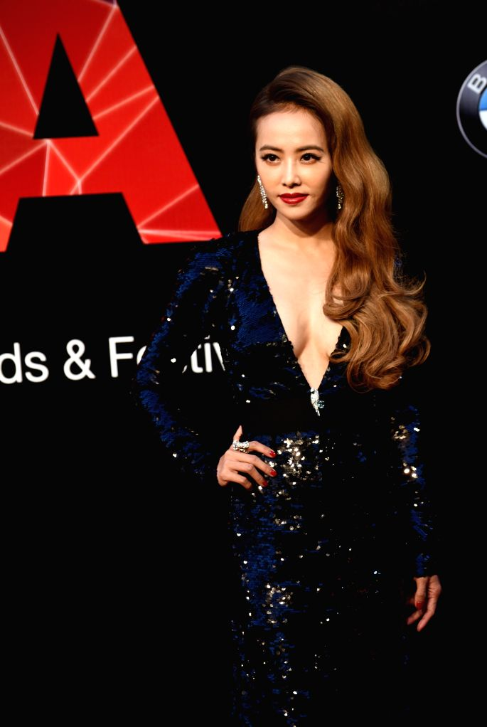 Singer Jolin Tsai poses on the red carpet as she arrives for the 26th Golden Melody Awards in Taipei, southeast China's Taiwan, June 27, 2015. (Xinhua/Wu ...