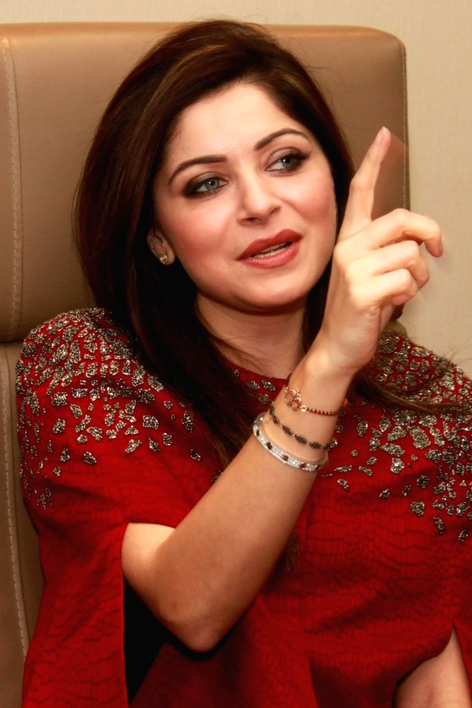 """Singer Kanika Kapoor during a programme organised to launch """"Super Girl From China"""" in Noida, on Dec 3, 2015. - Kanika Kapoor"""
