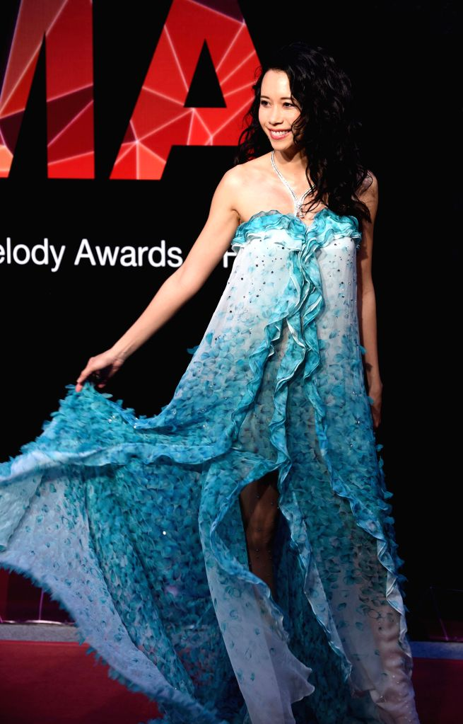 Singer Karen Mok poses on the red carpet as she arrives for the 26th Golden Melody Awards in Taipei, southeast China's Taiwan, June 27, 2015. (Xinhua/Wu ...