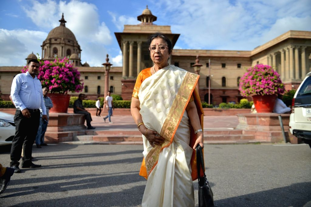 Singer Lata Mangeshkar's sister Usha Mangeshkar after meeting Union Home Minister Amit Shah to invite him for the launch of her coffee table book, at North Block in New Delhi on Sep 27, ... - Amit Shah