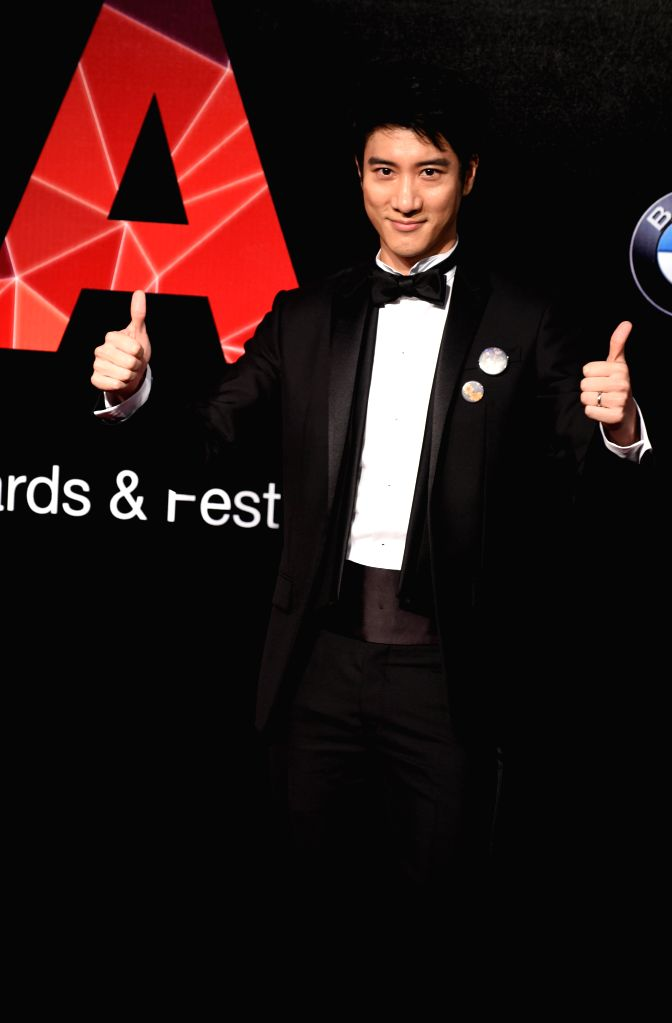Singer Leehom Wang poses on the red carpet as he arrives for the 26th Golden Melody Awards in Taipei, southeast China's Taiwan, June 27, 2015. (Xinhua/Wu ...