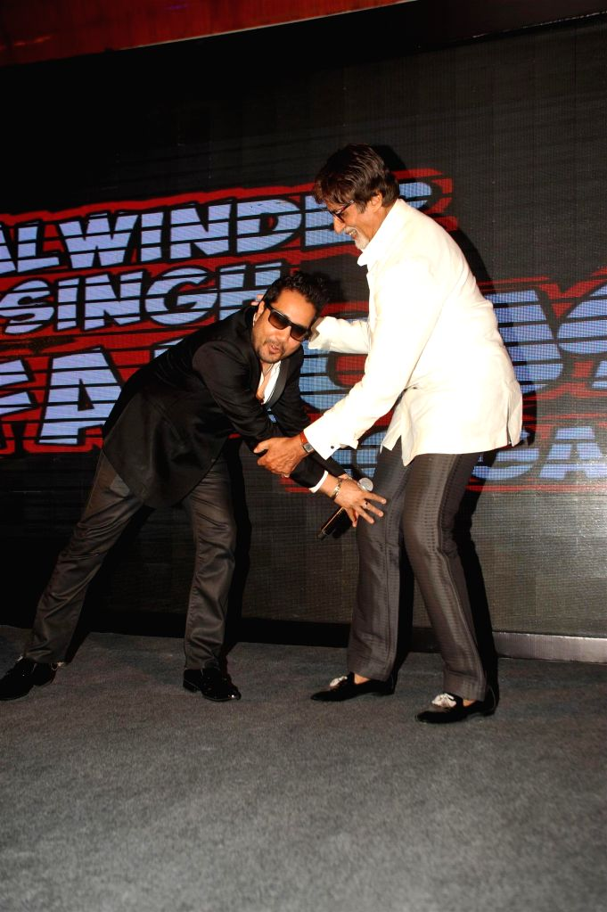 Singer Mika Singh and actor Amitabh Bachchan during the music launch of film Balwinder Singh Famous Ho Gaya in Mumbai, on Sept 9, 2014. - Amitabh Bachchan and Mika Singh