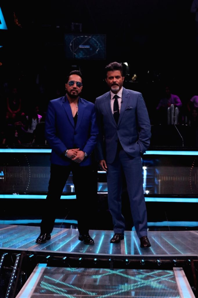 "Singer Mika Singh and actor Anil Kapoor on the sets of reality television show ""Dance Deewane"" in Mumbai on July 23, 2018. - Anil Kapoor and Mika Singh"