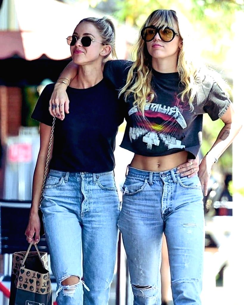 Singer Miley Cyrus and rumoured girlfriend Kaitlynn Carter sported matching outfits for an outing here. The couple were spotted here over the weekend wearing near identical looks, reports mirror.co.uk.