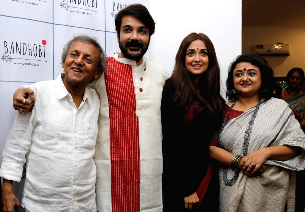 Singer Monali Thakur along with her father Shakti Thakur and actor Prosenjit Chatterjee during the inauguration of a store in Kolkata on Aug 1, 2017. - Prosenjit Chatterjee
