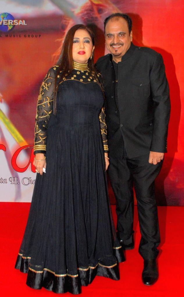 Singer Nikita H Chandiramani, with Mr.Chandiramani during the music release of album Kiran, in Mumbai, on Aug 18, 2014.