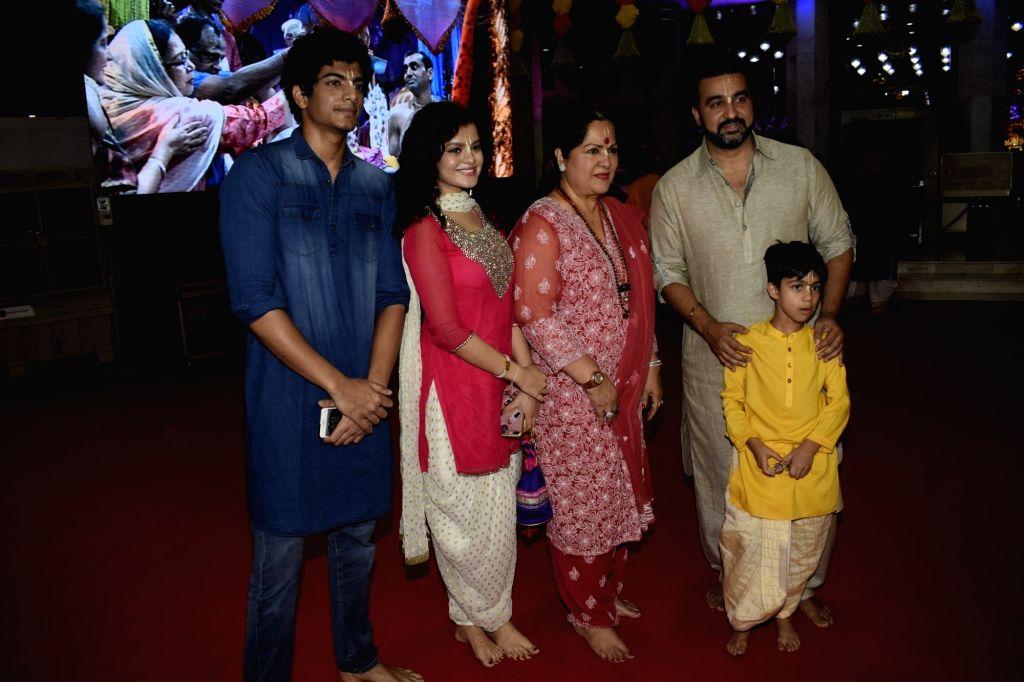 Singer Palak Muchhal, her brother Palash Muchhal, businessman Raj Kundra and others during Janmashtami celebrations at ISKCON temple, in Mumbai on Sept 3, 2018. - Raj Kundra