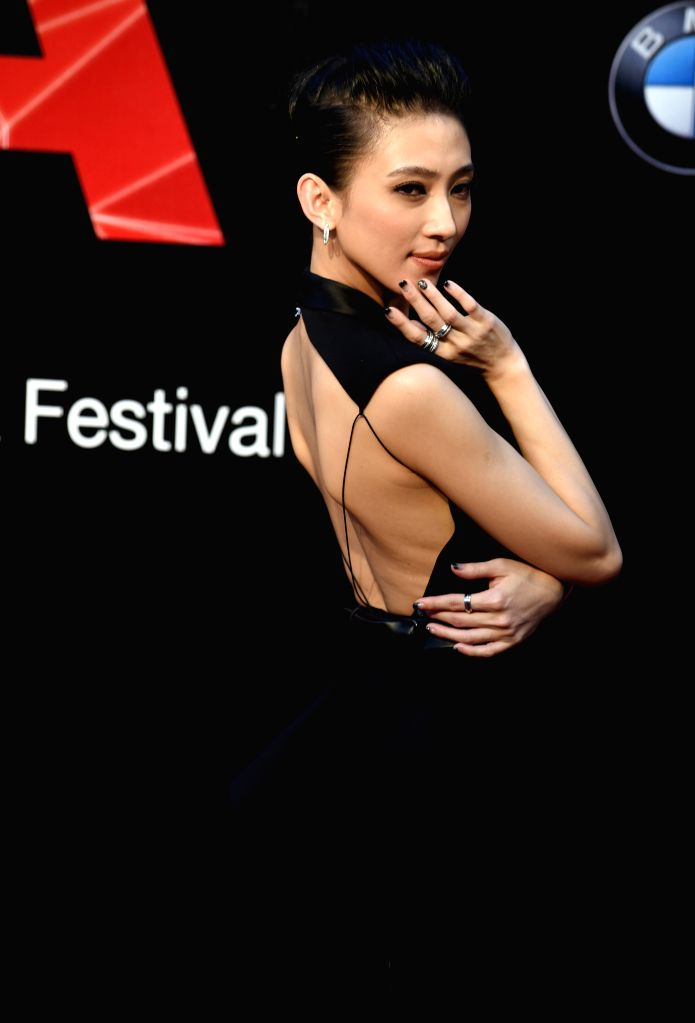 Singer Penny Tai poses on the red carpet as she arrives for the 26th Golden Melody Awards in Taipei, southeast China's Taiwan, June 27, 2015. (Xinhua/Wu ...