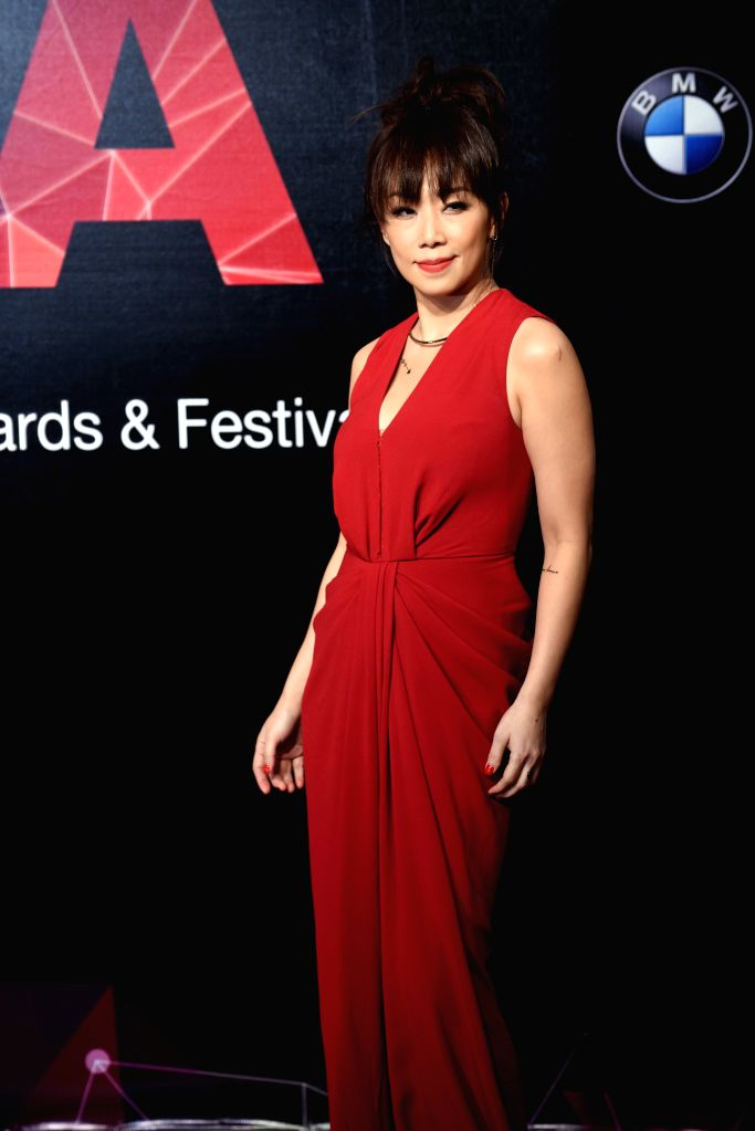 Singer Sandy Lam poses on the red carpet as she arrives for the 26th Golden Melody Awards in Taipei, southeast China's Taiwan, June 27, 2015. (Xinhua/Wu ...